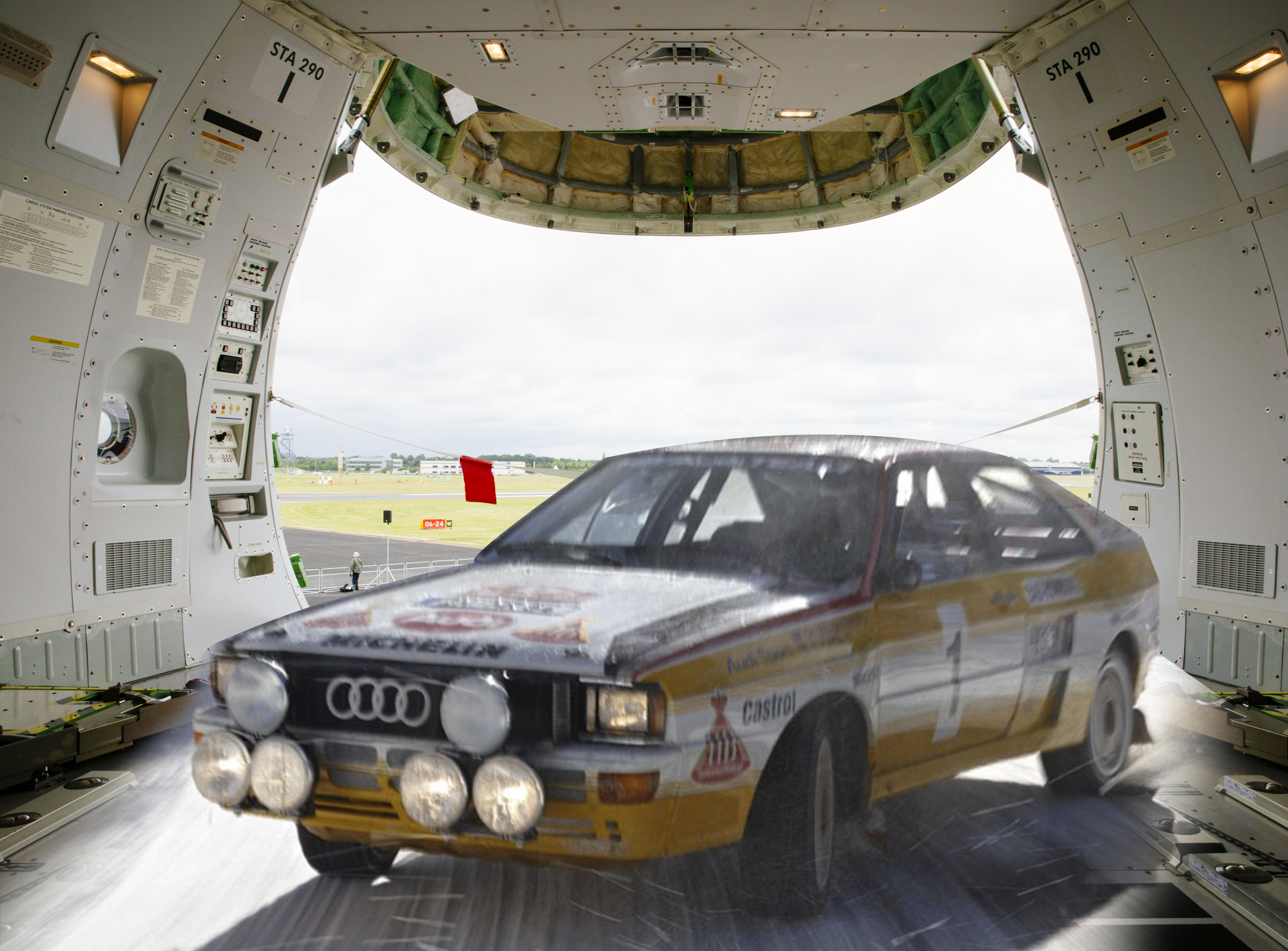 Audi ur-quattro Rally version is flying with an aircraft.